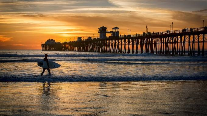 Surfing at Sunset by crystaljohnson_7387 - Outdoor Action and Adventure Photo Contest by Focal Press