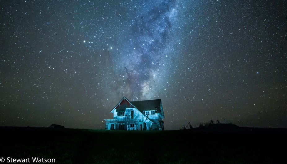 Shooting star over the haunted house
