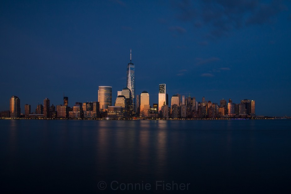 The sun had already set, but the glow reflected off the towers of lower Manhattan from across the...