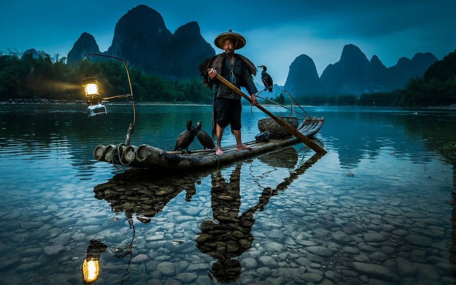 Guilin, China. Mr Huang is the last of 4 generations of cormorant fishermen on the Li River, in G...
