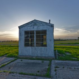 Surrounded by three intersecting highways, lies this almost forgotten weigh station shack.  Though its windows are almost all broken out, it stil...