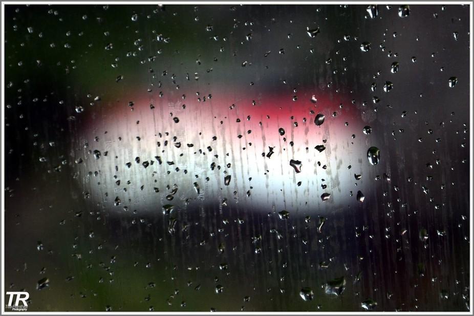 YMA Flag through my car glass under a rainy day.