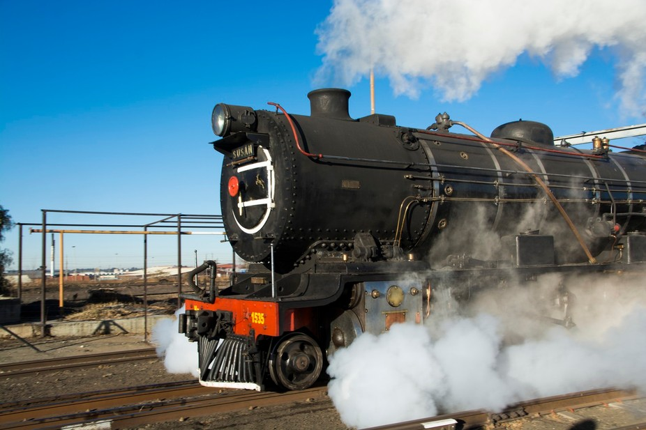 Steam Locomotive puffing along in full steam.