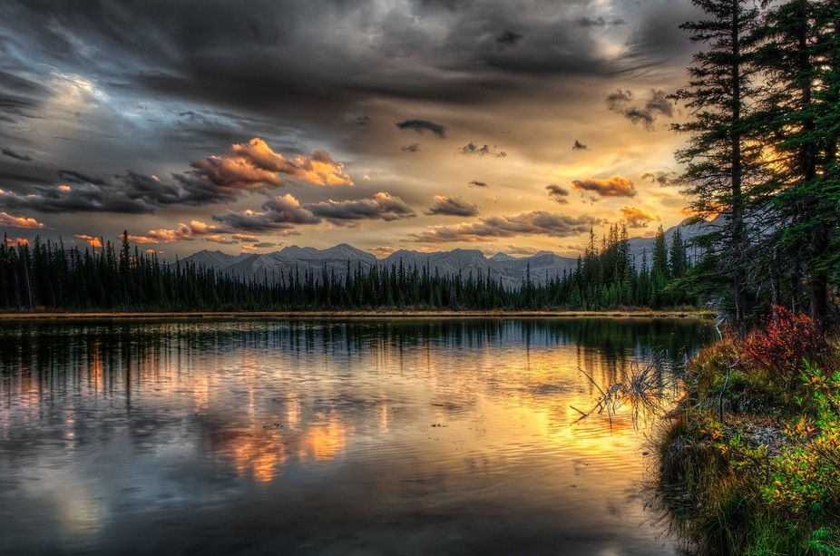 lake at sunset.this was taken between calgary and canmore in alberta,canada..i was driving past a...