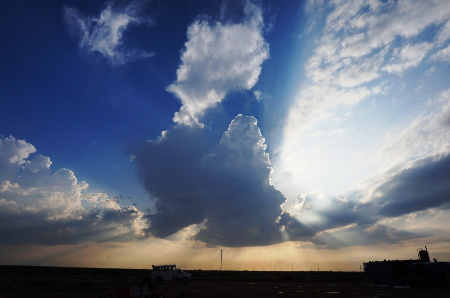 5/18 storm with sun setting behind it. north of pecos, tx