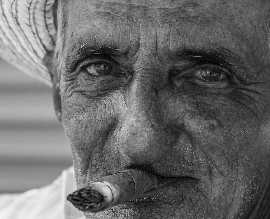 This man was sitting on a bench on a square in Viñales, looking the typical Cuban guy with his c...