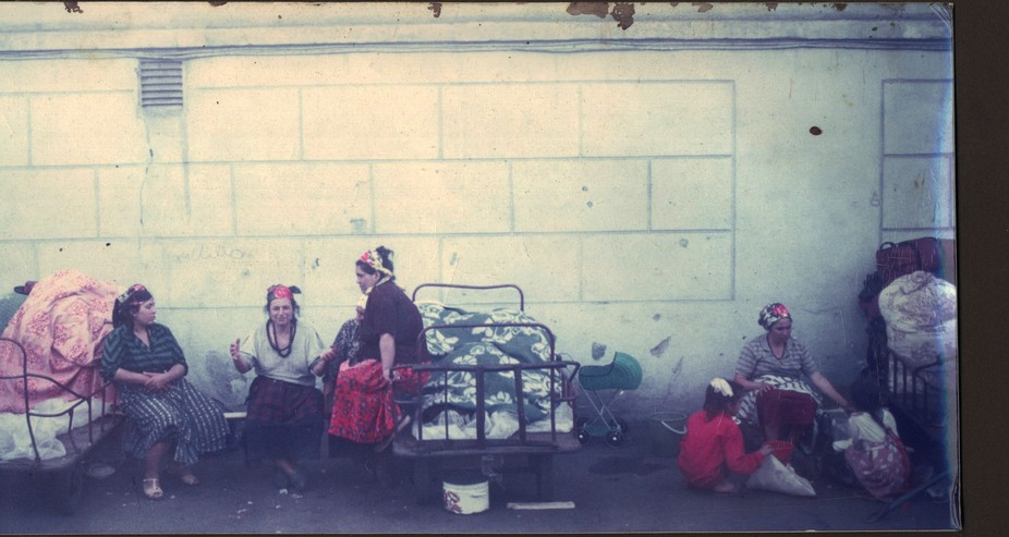 Gypsies living on a train platform of the Trans-Siberian Express.  I shot this out a train window...