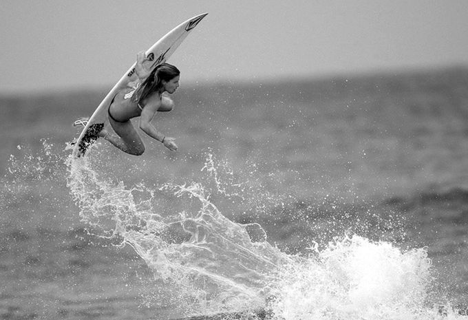 Surfer Girl Getting Air by DugzPhotos - Outdoor Action and Adventure Photo Contest by Focal Press