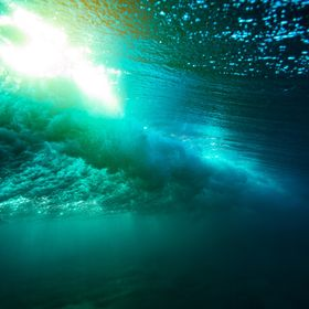 Rolling waves from under the surface. Shot on the Gold Coast of Australia as the light was falling.