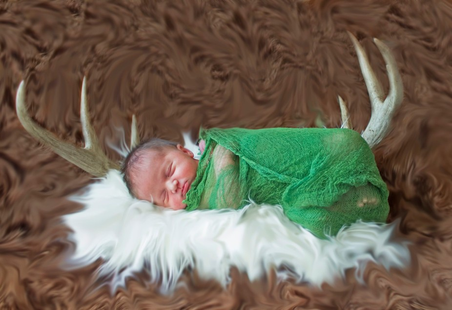 These antlers are ones my dad kept from one of his bucks. The little one is my daughter at a week...