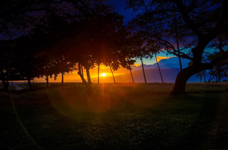 Lavender and orange fill the sky as the sun sets over Maui.