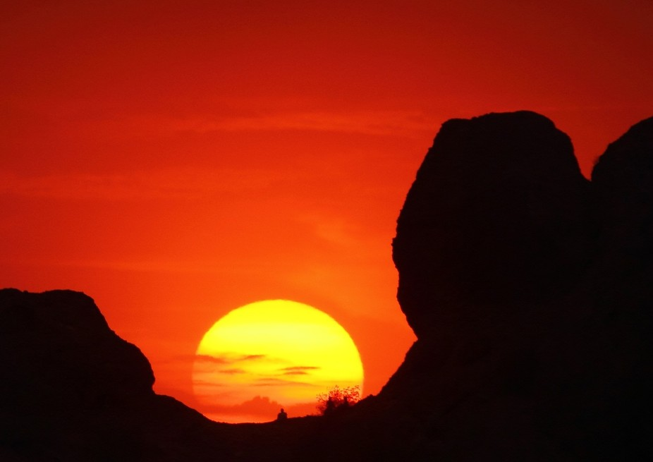 Sunset in Phoenix, Arizona, from The Hole In the Rock in Papago Park.  You can see three people s...