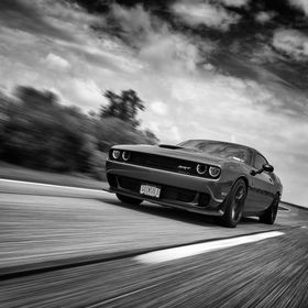 Rolling shot of a Dodge Challenger Hellcat.