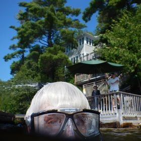 A selfie of myself, using an underwater camera, just as I came to the surface, while snorkeling in cottage area of Ontario.