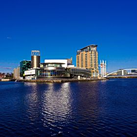 Taken in the evening as the sun was going down over Manchester, the Lowry Centre at Salford Quays lit up with reflections in the dark waters of t...