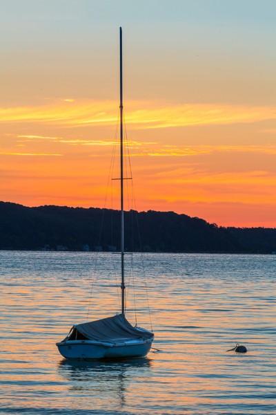 Sailboat on Lake at Daybreak