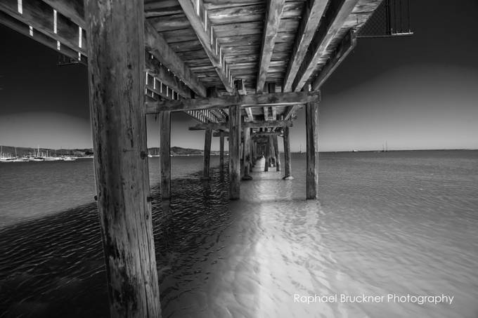 Pier in Black and White by raphaelbruckner - A Black And White World Photo Contest