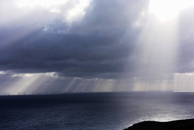 rays of light over wind farm
