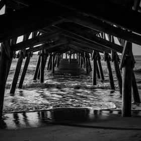 Black and White under the pier at Surfside