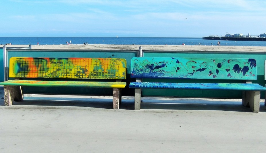 Two colourful benches, spotted in Santa Cruz