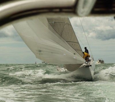 French yacht surfing in lively condtions, in a race around the Isle of Wight, UK