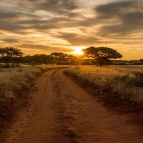 The road and adventure beckon at sunrise in the Northern cape, South Africa