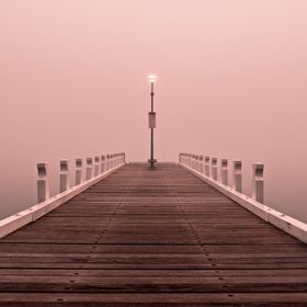 A foggy morning over the waters of Corio Bay, Geelong, Australia.