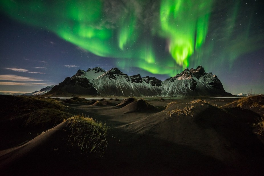 The Northern Lights flowing over Vestrahorn and the black-sand dunes.  On our second night in #Ic...