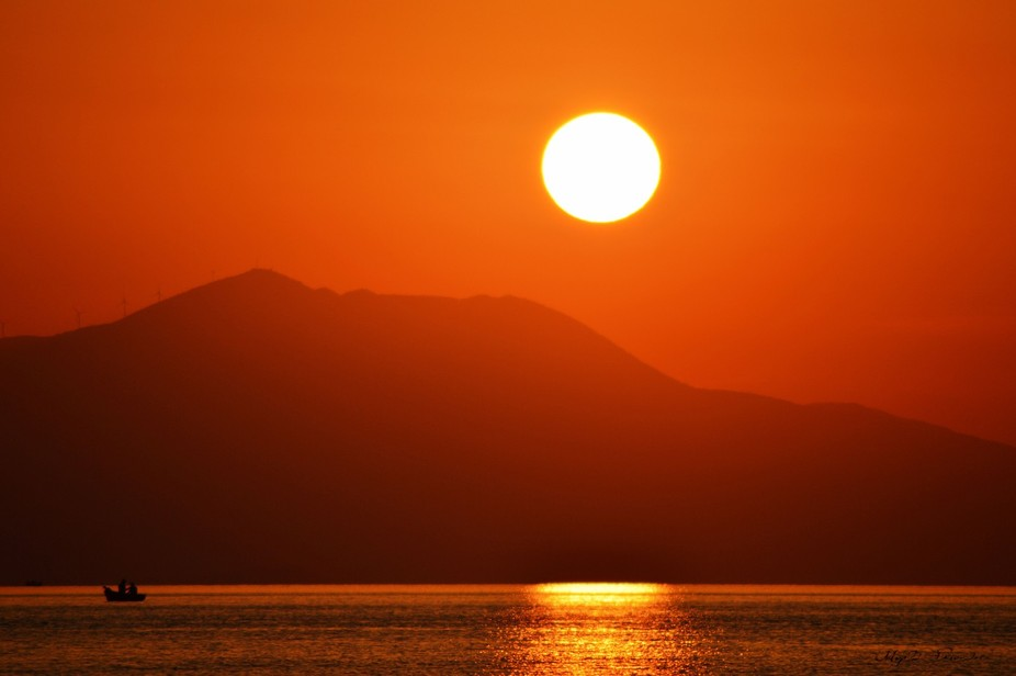 Red sunrise over Corinthian Gulf on the morning of August 14th.