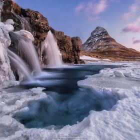 Kirkjufell Foss is a waterfall located along the Snæfellsnes Peninsula with the peculiarly shaped Kirkjufell Mountain.