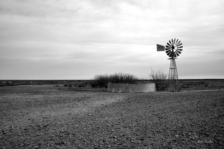 Windmill and dam in the Karoo region of S. Africa