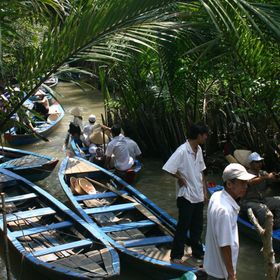 Tour boat in Vietnam taking passengers along the Mekong River, A predominant river that runs through Vietnam.