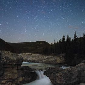 Using a high ISO of 12800 I was able to capture the water of Elbow Falls and the night stars.