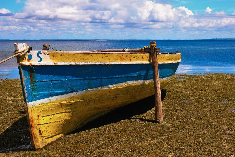 A small dhow on a beach in the north of Mozambique, waiting for the tide.