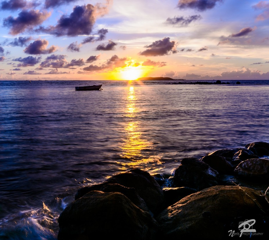 Sunrise in Fajardo. Managed to get this lone boat drifting away to the sunrise