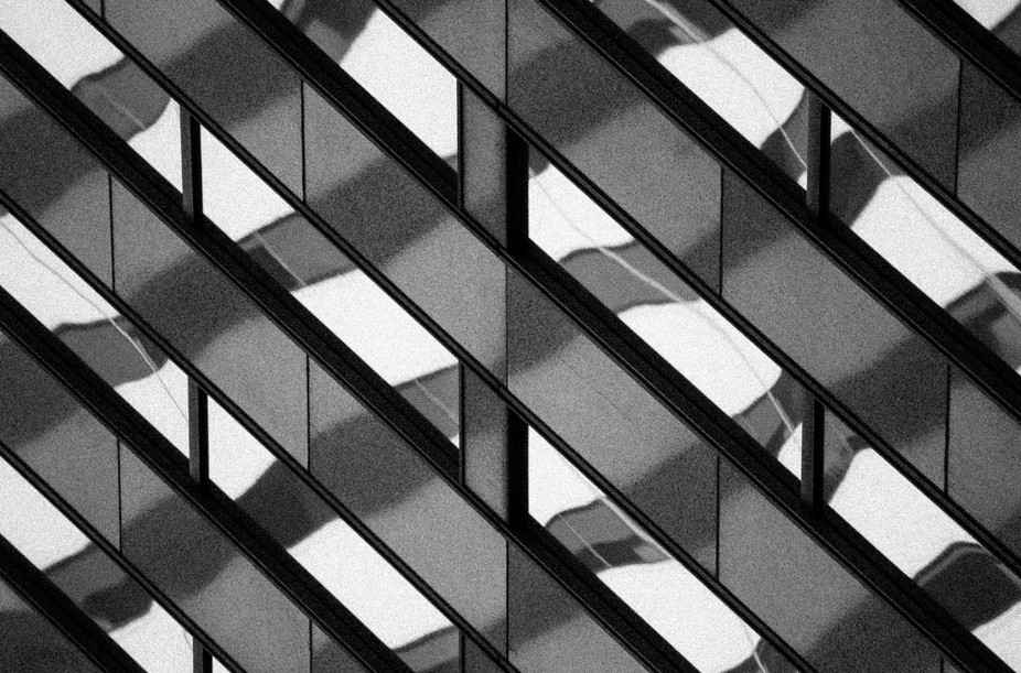 This is part of a series of abstract photographs of the reflections of building windows in downto...