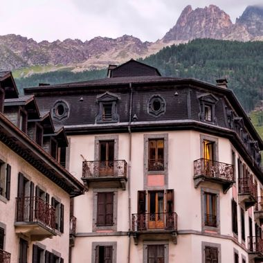Mountains tower above the streets of Chamonix. The hotels are attractive French styling.