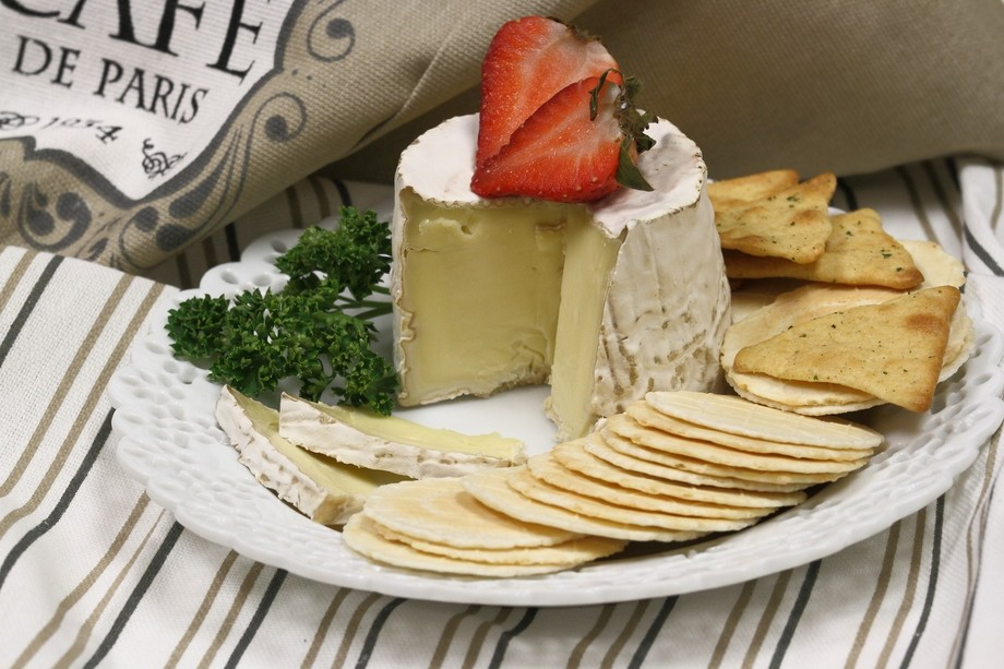 Cheese and crackers with a little strawberry.