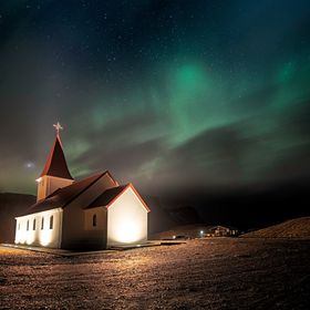 Northern Lights over famous Vik church.  Every night in Iceland a photographer look at weather and aurora forecasts, trying to chase every small ...