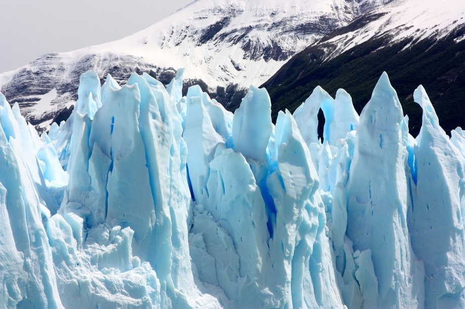 The blue ice of the glacial spires in Southern Argentina start to melt and break apart as they ap...