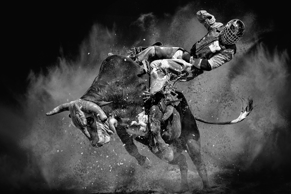 This Rodeo bull riding contest is going the Bull's way as the cowboy starts to lose his ...