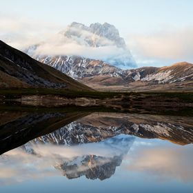 Reflection of Corno grande in a small lake, I decided to do not edit this photo to remember that only the reflection is perfect with a blue sky w...
