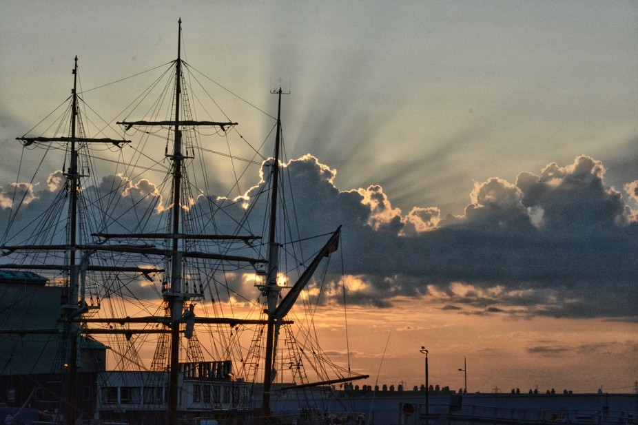"The sailing vessel ""Pelican of London"" alongside Weymouth harbour at sunset"