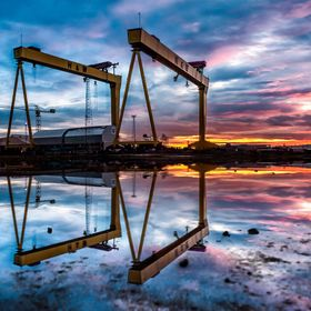 Harland & Wolff's legendary Samson and Goliath cranes at Belfast's shipyard during dawn.