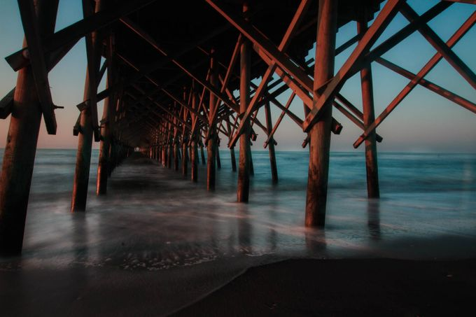This is under the Folly Beach Pier on Folly Beach, SC. For some reason a few days of the year the water turns really blue.