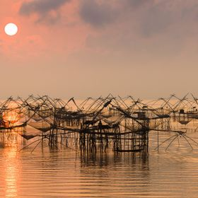 Beautifull sunset over the square fishing nets in Pathalung, Thailand.