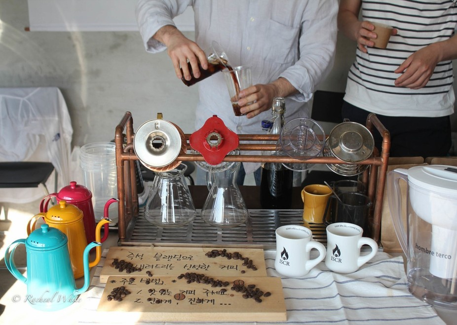 The owner of this cute little garage coffee shop in Seoul whips up a special concoction for me ma...