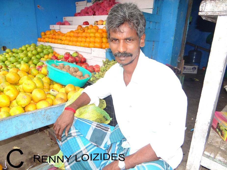 A  greengrocer, waiting for the next customer, in Mahabalipuram