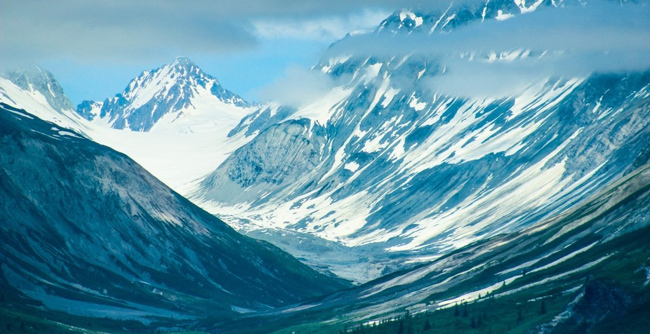 A look from above at a remote valley amid the mountain range in Alaska