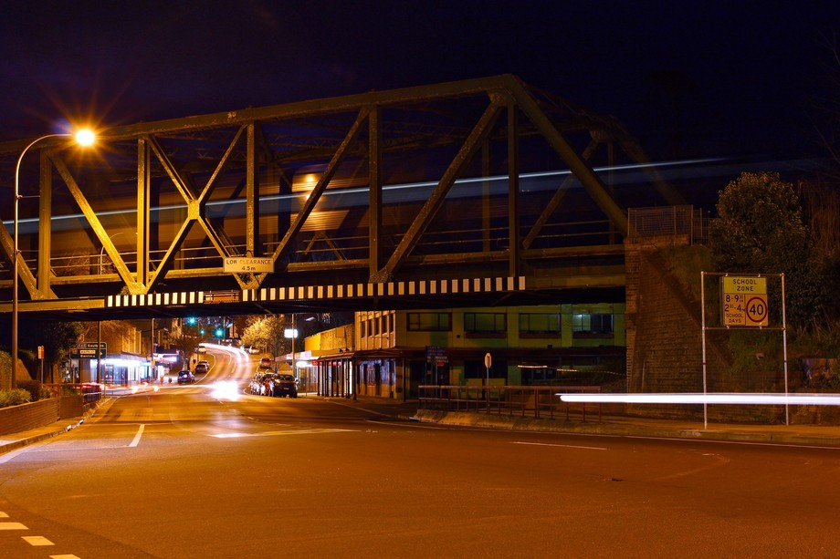 Long exposure of a train crossing an overpass.